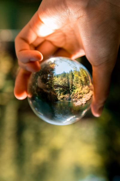 person-holding-clear-glass-ball-1296265-scaled.jpg