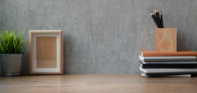 photo-of-wooden-table-with-objects-near-gray-wall-3787776